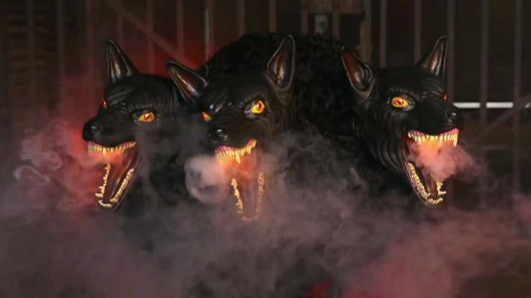 cerebus three headed dog A custom carved cerberus three headed dog statue complete with faux stone  carved base and dramatic up lighting for a dynamic mythology diorama.